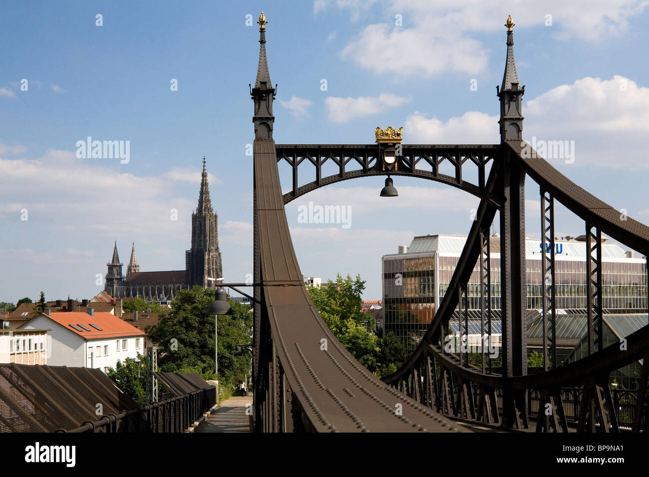 Ulm Minster stands beyond the  Neutor Bruecke (New Gate Bridge) in Ulm, Germany. - Stock Image