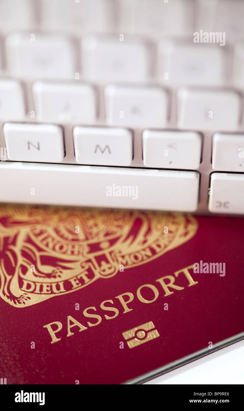 Passport with a computer keyboard - Stock Image