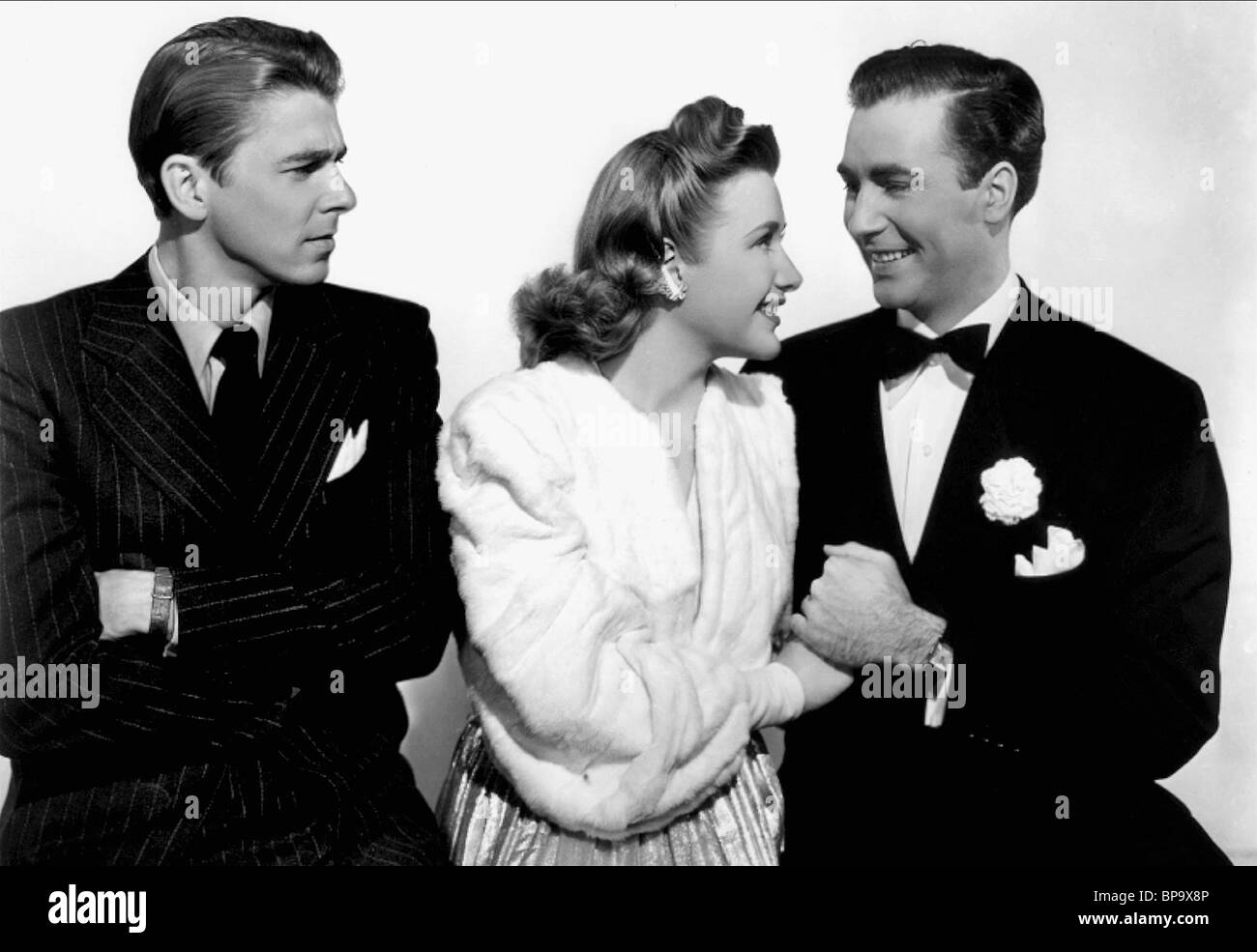 RONALD REAGAN PRISCILLA LANE JEFFREY LYNN MILLION DOLLAR BABY (1941) - Stock Image