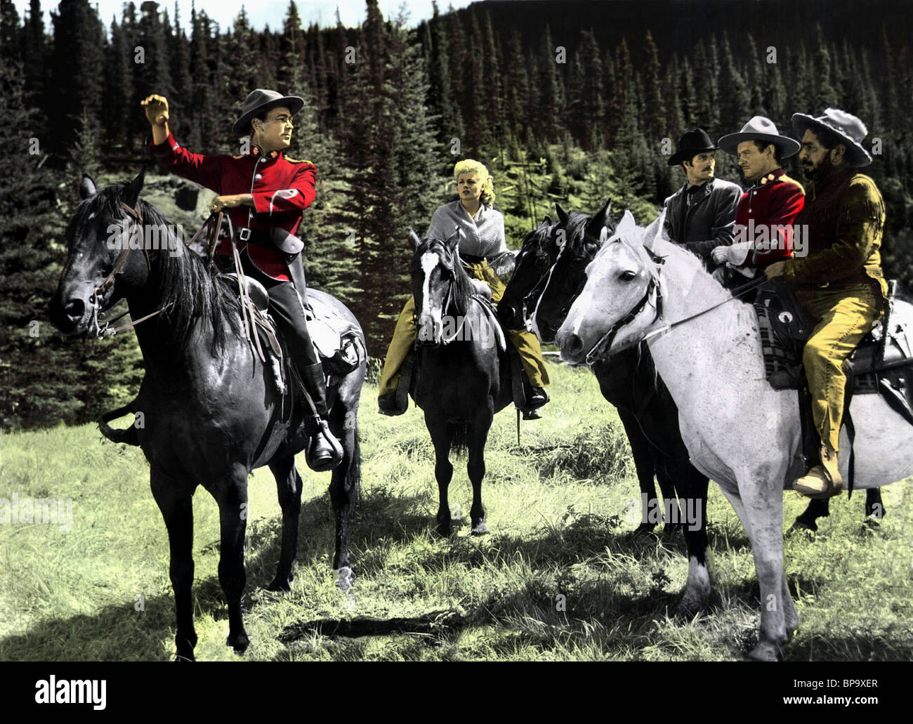 ALAN LADD & SHELLEY WINTERS O'ROURKE OF THE ROYAL MOUNTED; SASKATCHEWAN (1954) - Stock Image