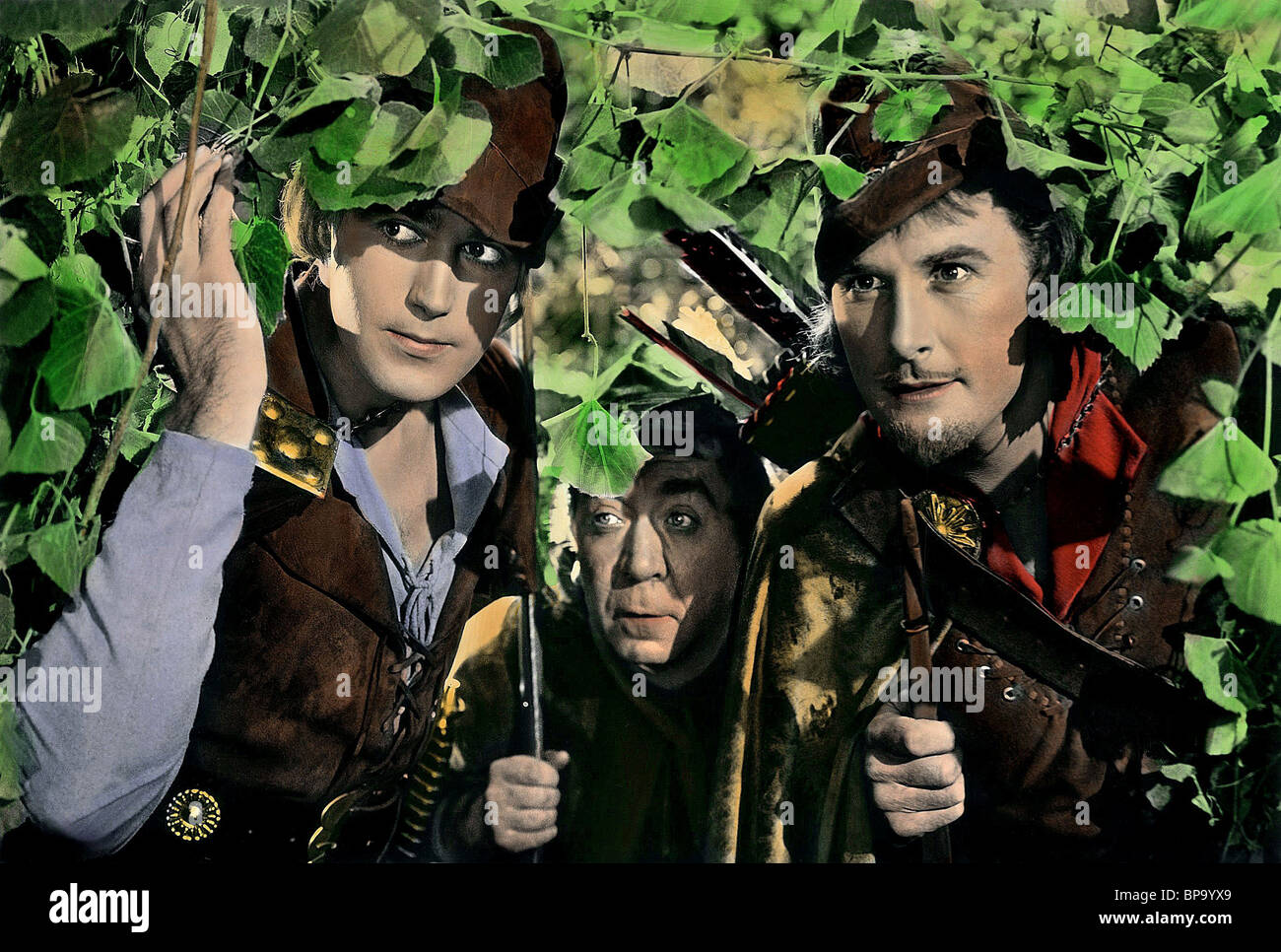 PATRIC KNOWLES EUGENE PALLETTE ERROL FLYNN THE ADVENTURES OF ROBIN HOOD (1938) - Stock Image
