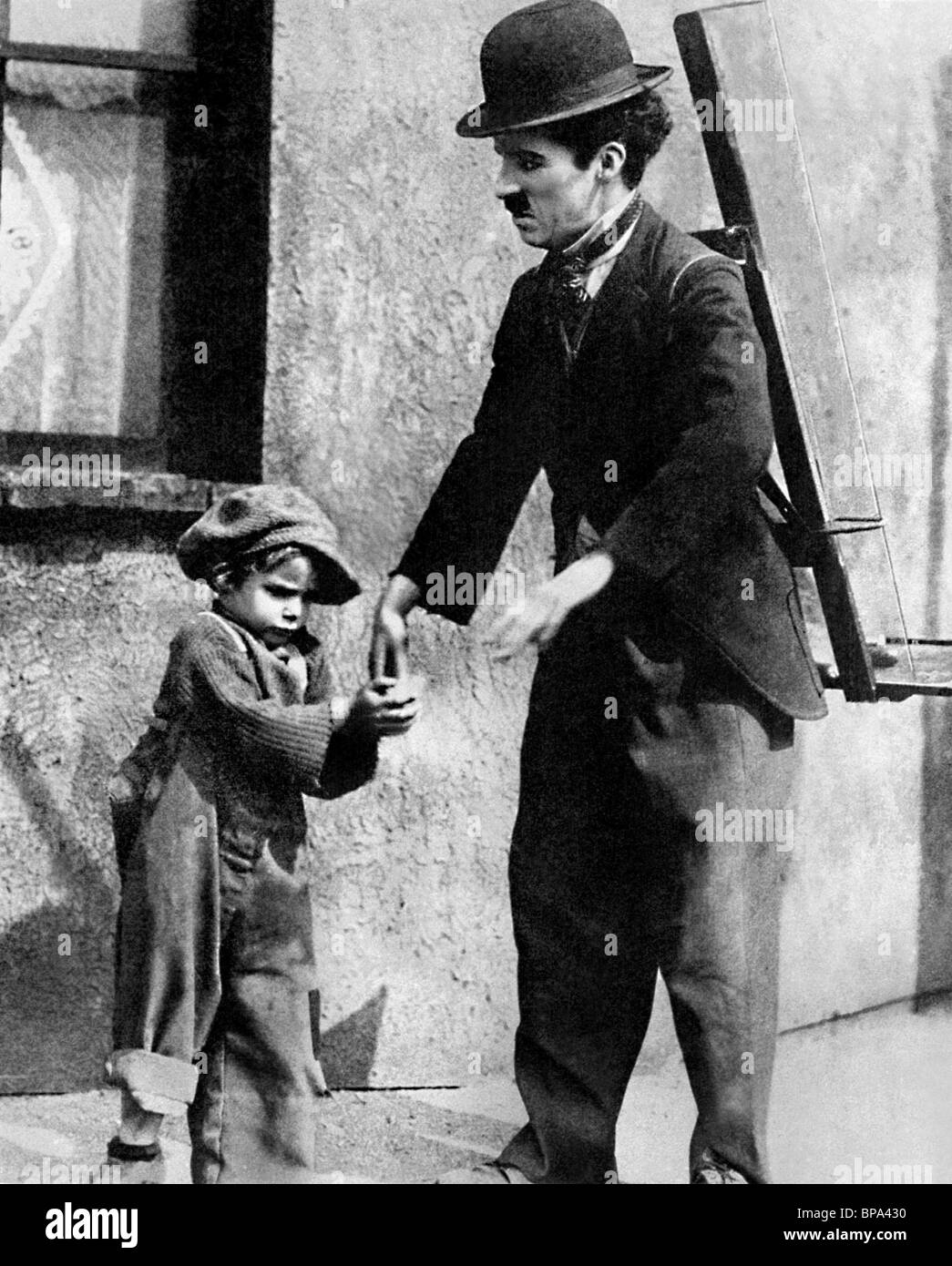 charlie chaplin the kid essay Synopsis of the kid exactly as written by the chaplin studio in 1921 by listing the cast simply as the man, the woman, the tramp and the policeman, we have already the constituent elements of a drama.