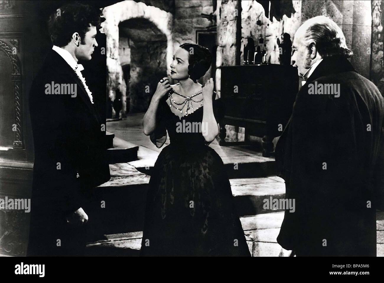RICHARD BURTON OLIVIA DE HAVILLAND & RONALD SQUIRE MY COUSIN RACHEL (1952) - Stock Image