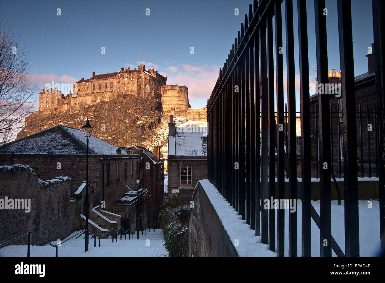 Edinburgh Castle in winter with snow on the ground but under sunshine and blue skies.  Image has a 'period', - Stock Image