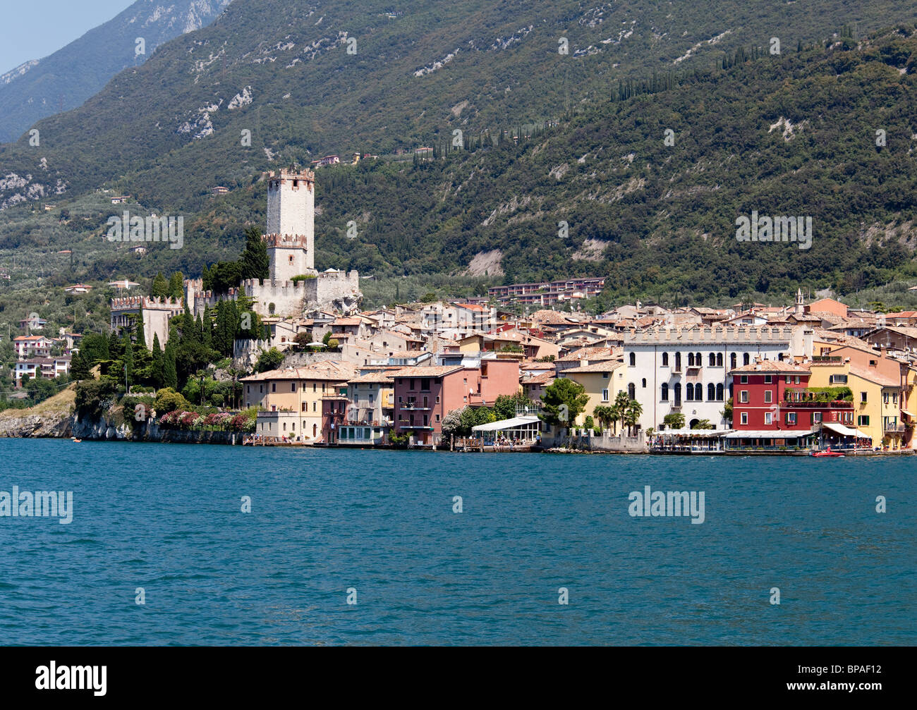 View off the coast of Malcesine on Lake Garda with the castle framing the town - Stock Image