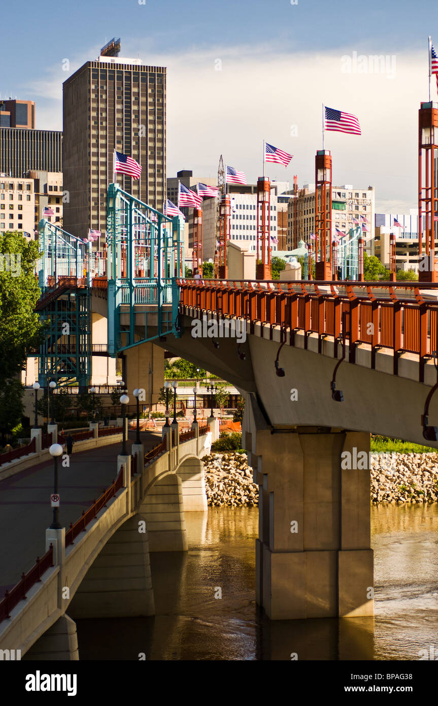 US flags line the Wabasha Street bridge over the Mississippi River on a summer morning in downtown Saint Paul, Minnesota. - Stock Image