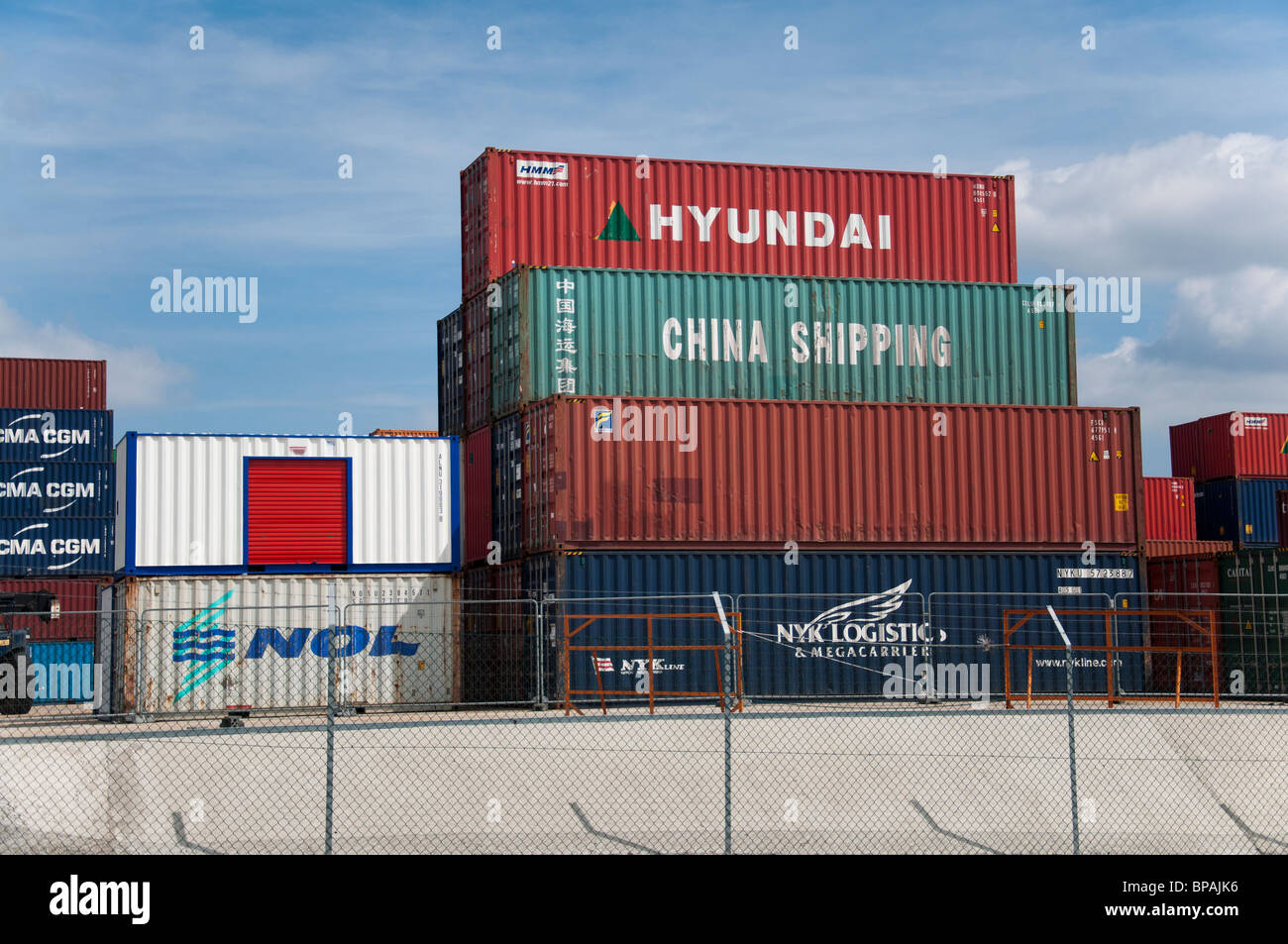 Shipping containers stacked up at Southampton docks in Southampton, England. Stock Photo