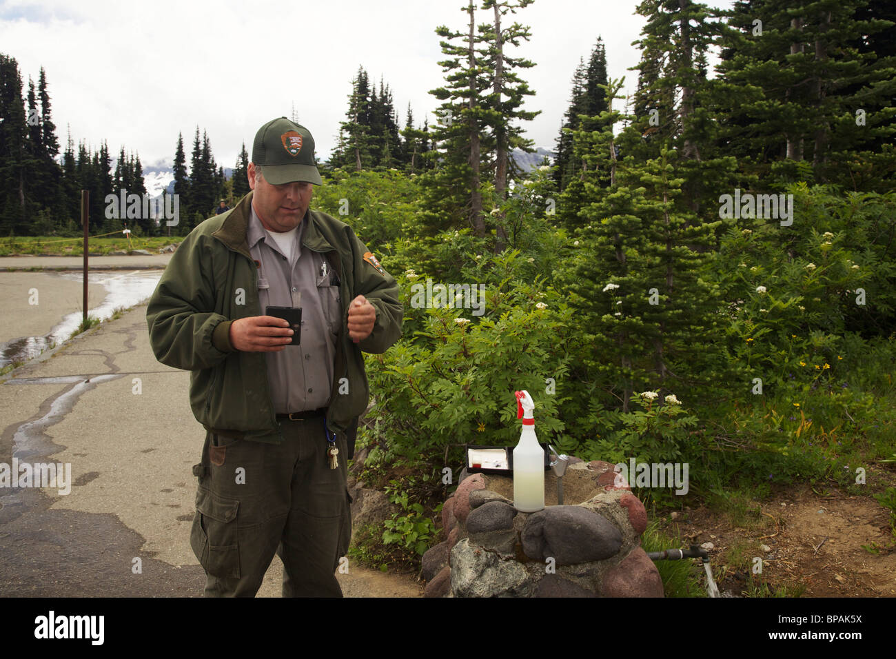 Park worker testing water fountain quality. Mount Rainier National Park, Washington. - Stock Image
