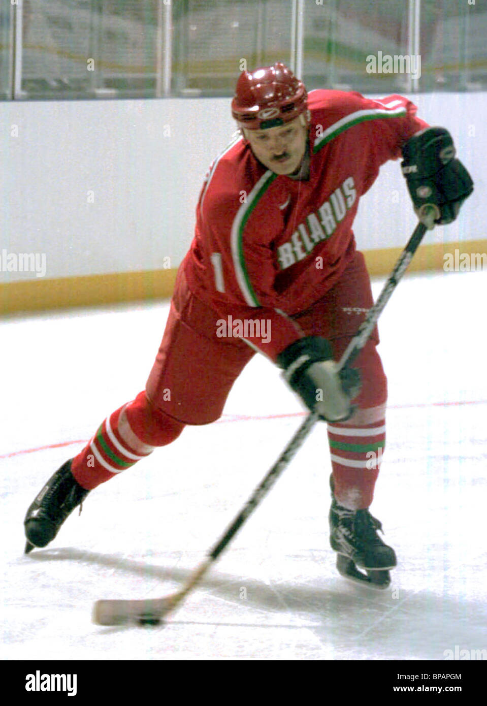 Belarussian Presient Alexanser Lukashenko tests the ice of a newly opened sports palace - Stock Image