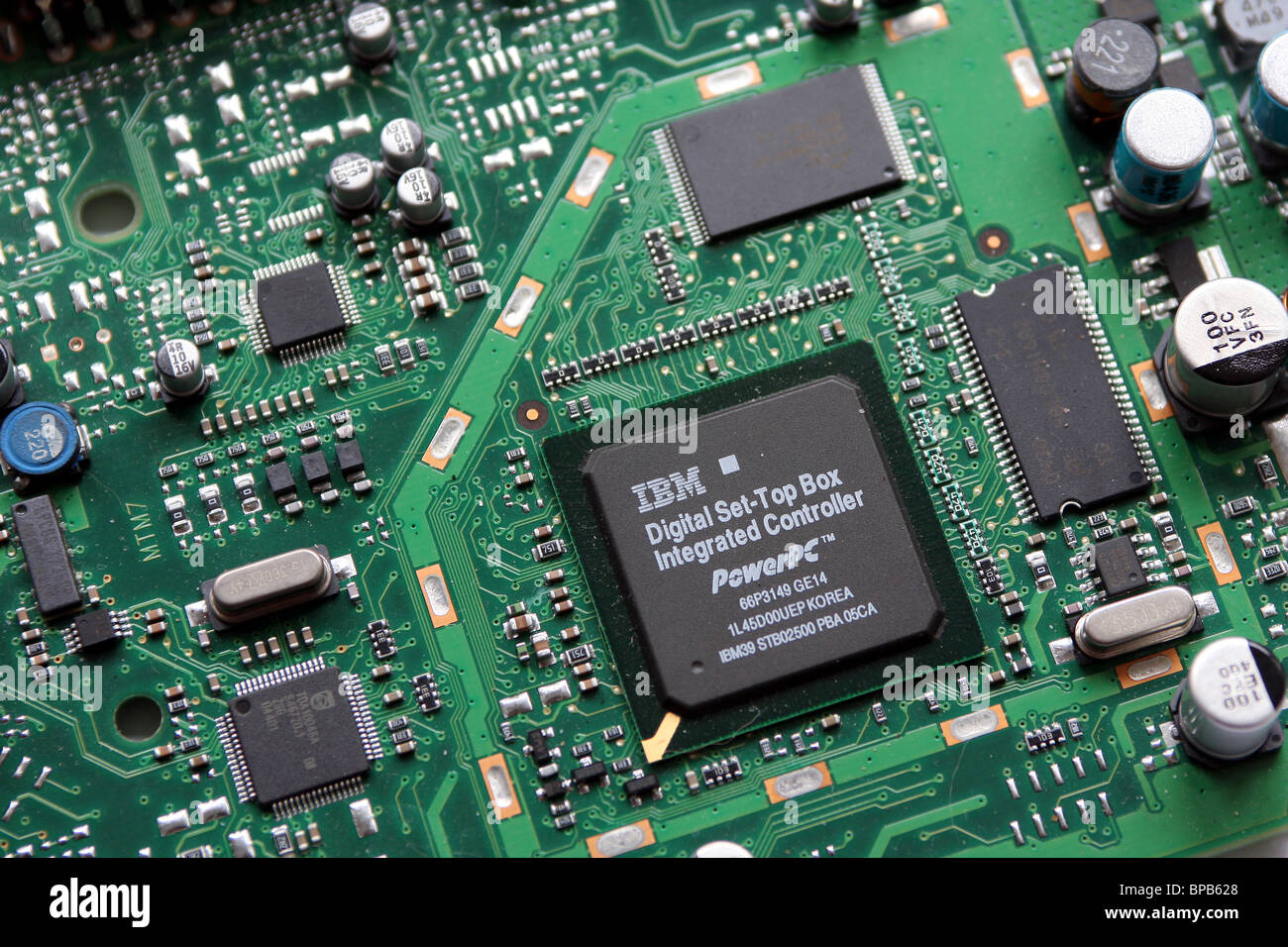 Printed Circuit Board of a DVB digital Television receiver box made by Sagem to receive free to air terrestrial - Stock Image