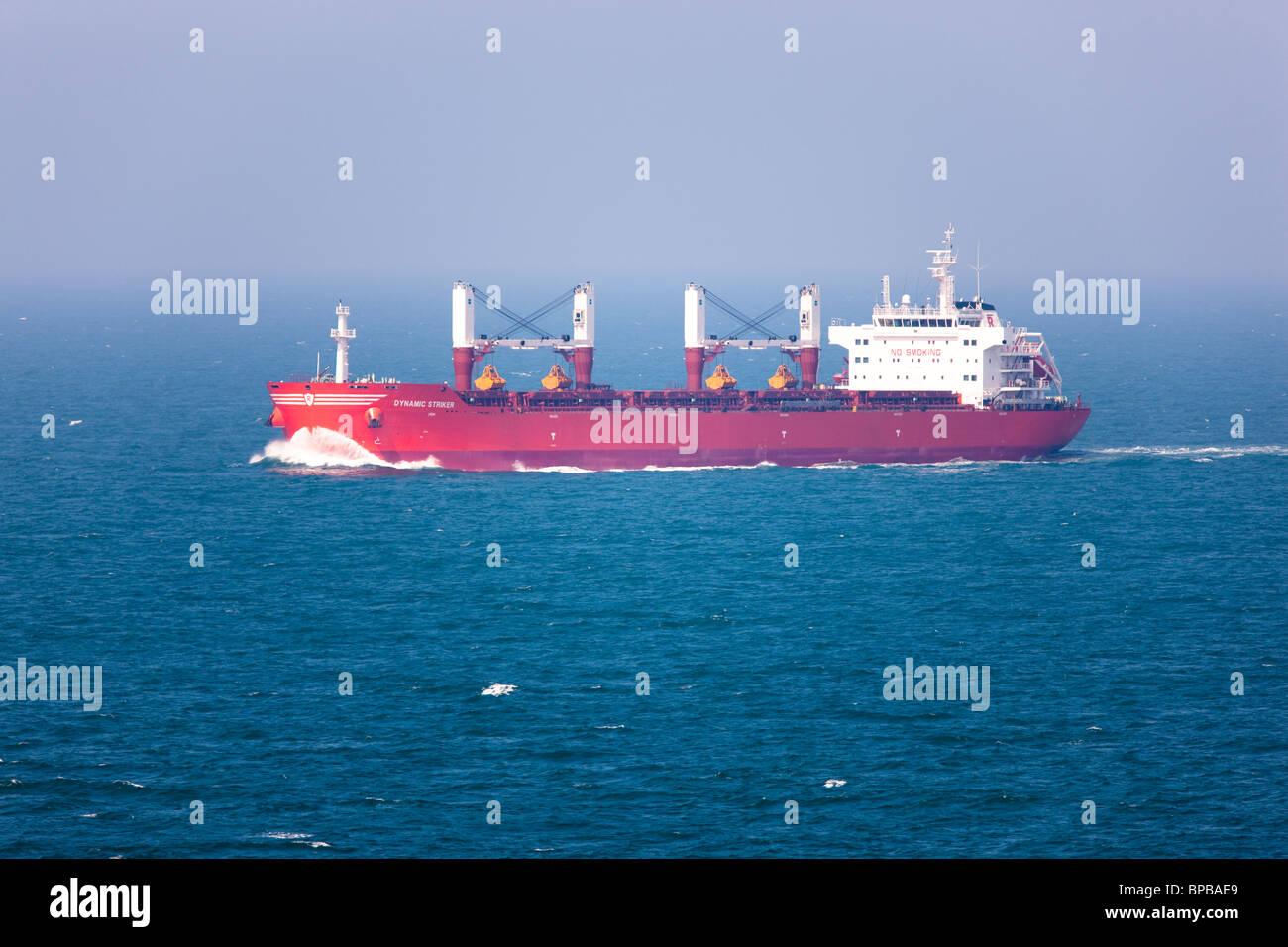 cargo ship dynamic striker at sea - Stock Image