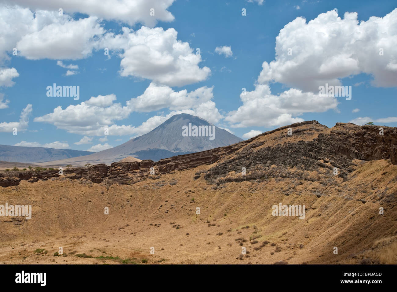 Caldera and the active volcano Ol Doinyo Lengai in the Rift Valley of Tanzania - Stock Image