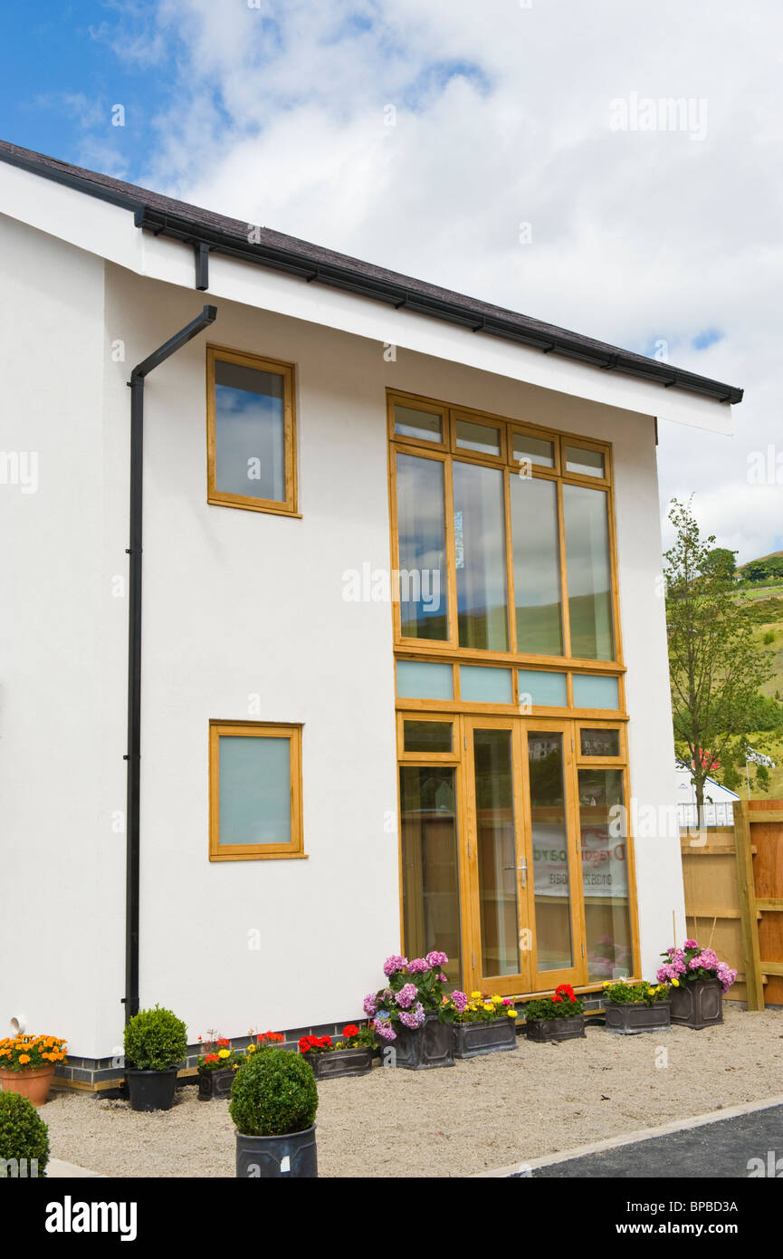 Energy efficient environmentally sustainable house highly insulated with triple glazed south facing windows in UK - Stock Image