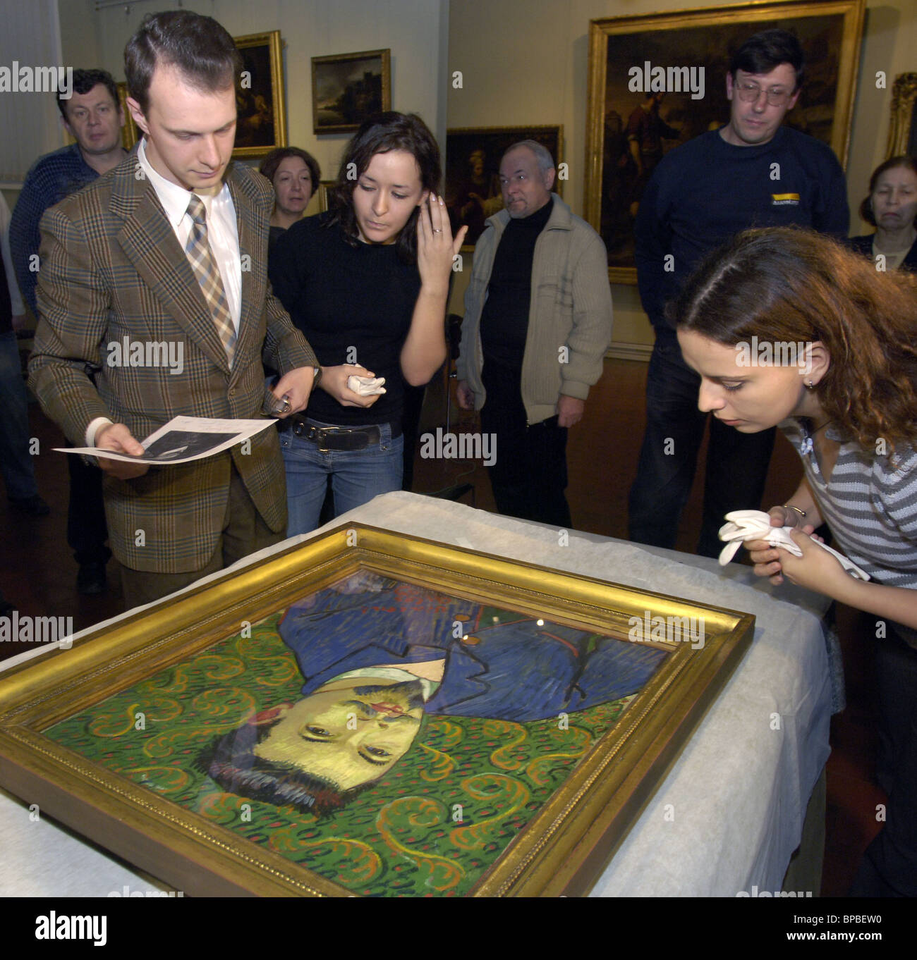 Experts examine painting by Vincent van Gogh which returned from Switzerland Stock Photo