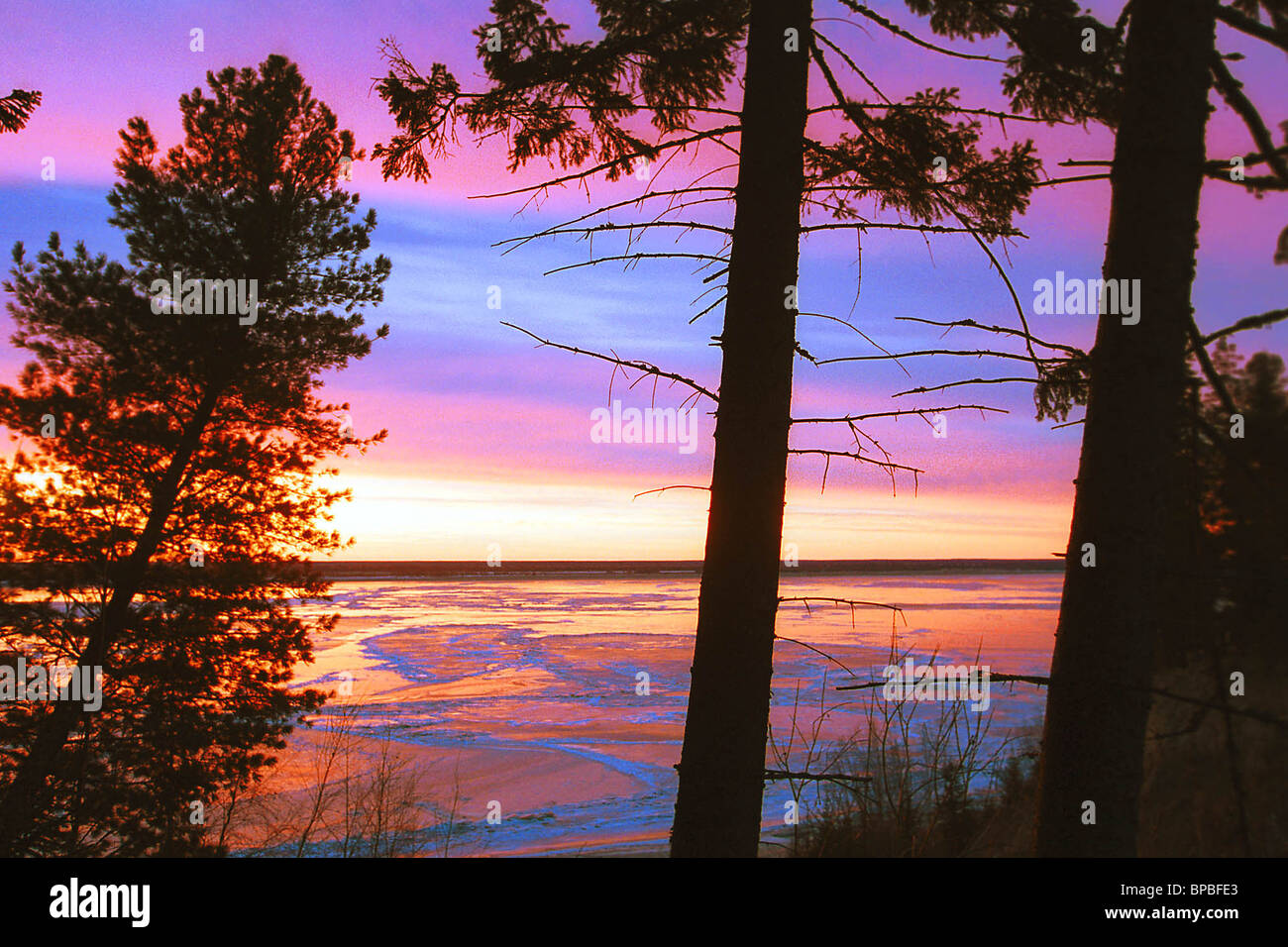 The fantastic colours of the sunset sky fascinate the eyes - Stock Image