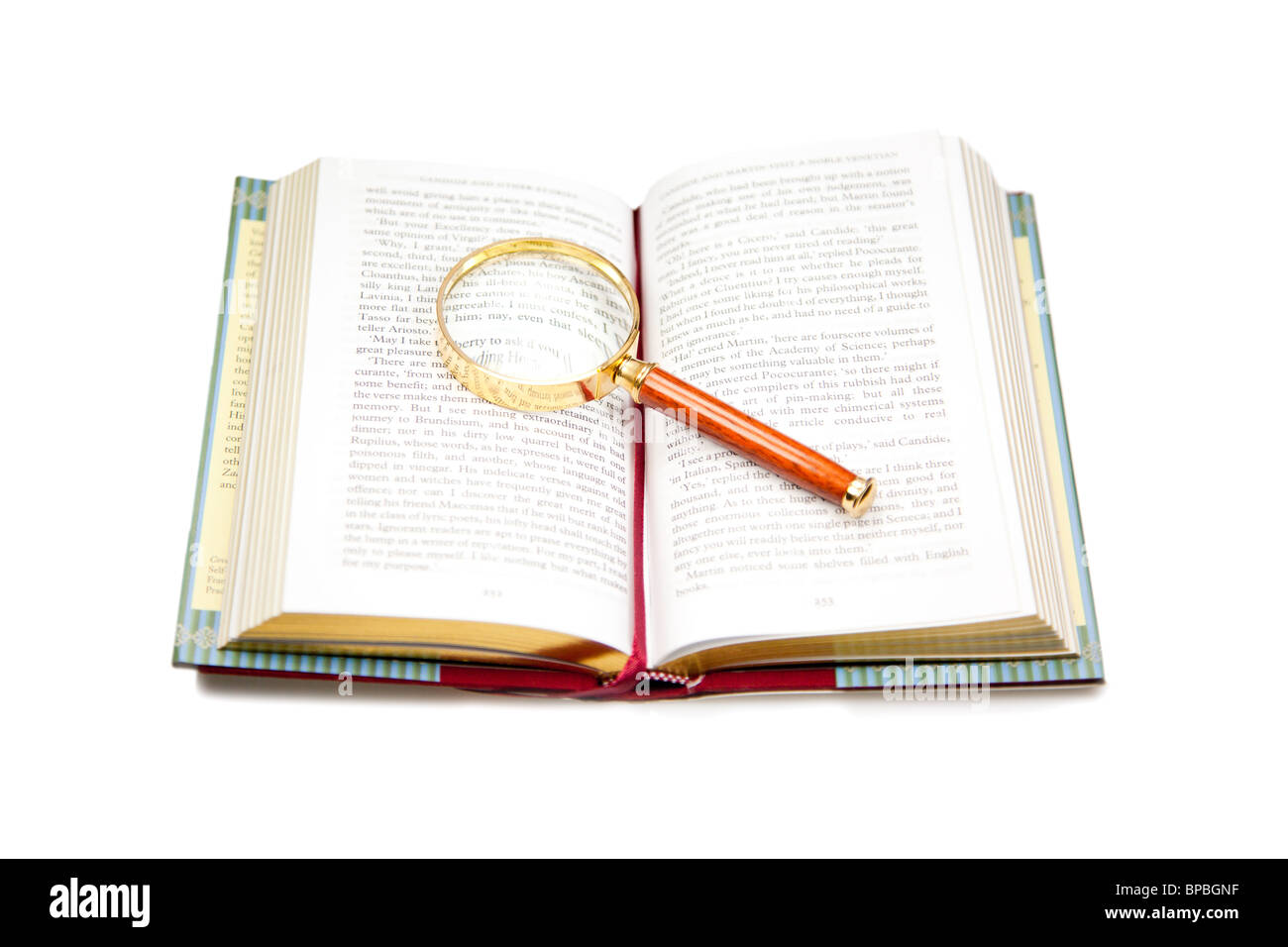 Open book with magnifying glass isolated on white. - Stock Image