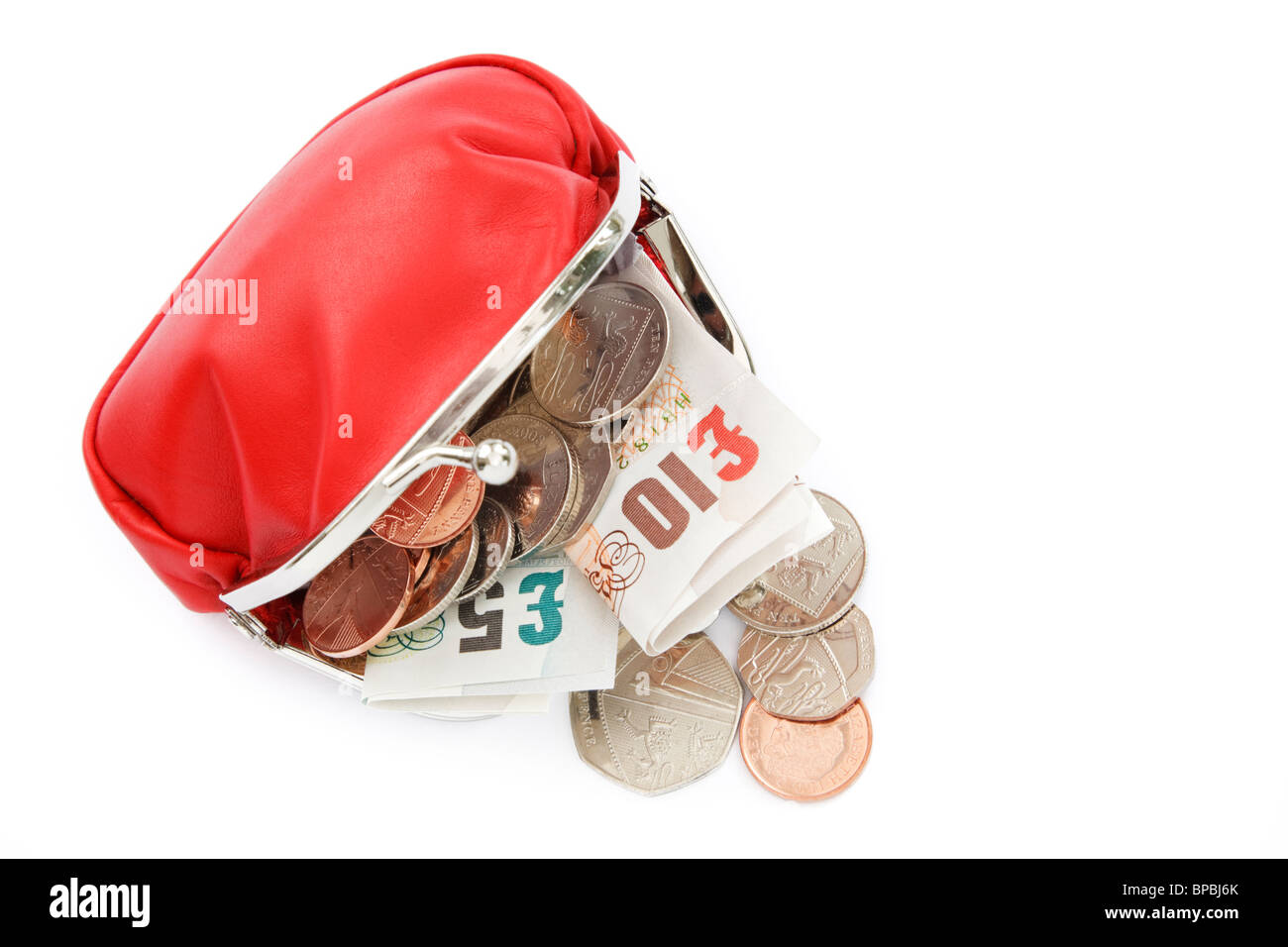 Isolated open red coin sterling money purse containing ten and five British pound notes GBP with some cash coins - Stock Image