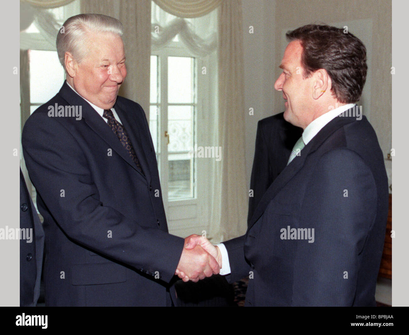 Yeltsin shaking hands with Schroeder on a filer - Stock Image