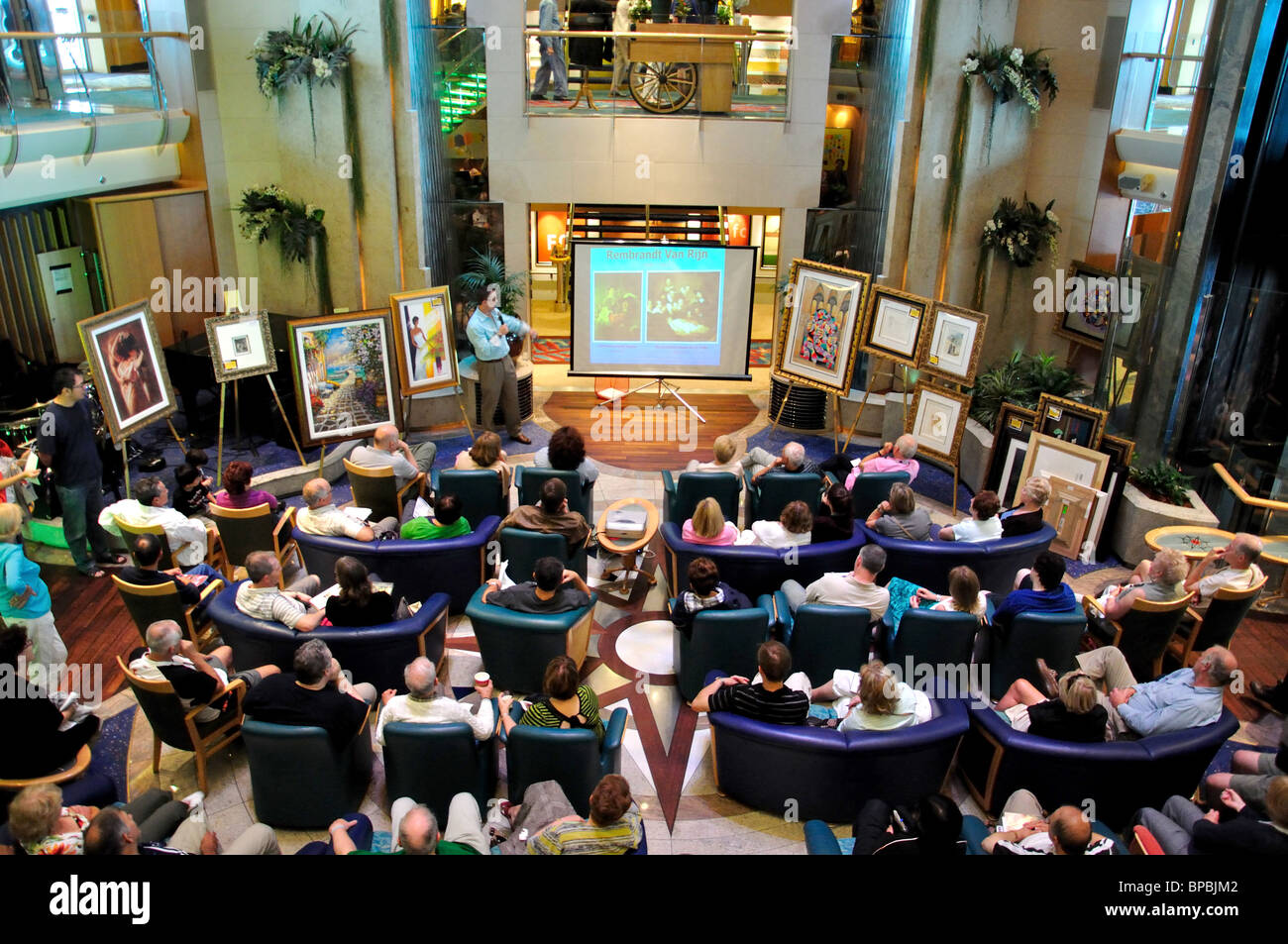 Art auction in The Centrum, The MS 'Jewel of the Seas' Royal Caribbean International cruise ship, North - Stock Image