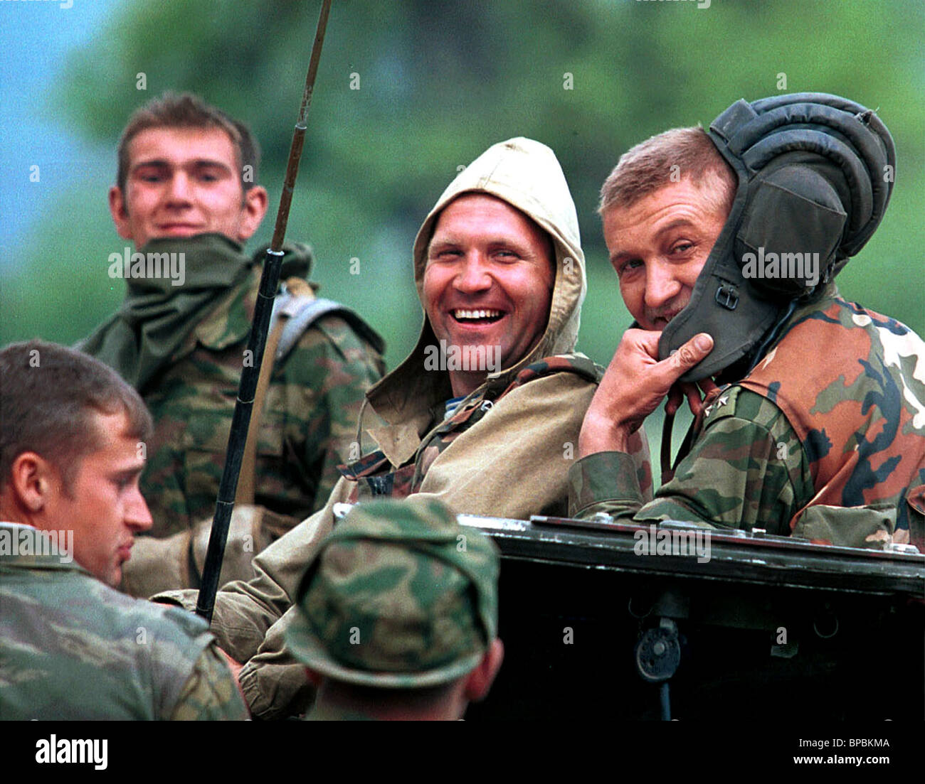 Paratroopers of the Ryazan 137th airborne regiment are happy to finish a regular fighting against gunmen without - Stock Image