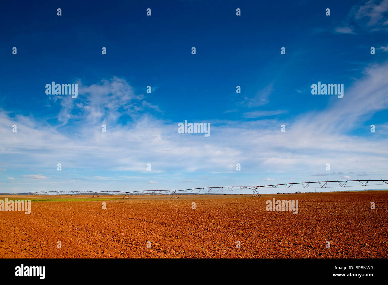 Agriculture farm being irrigated by industrials mechanisms - Stock Image