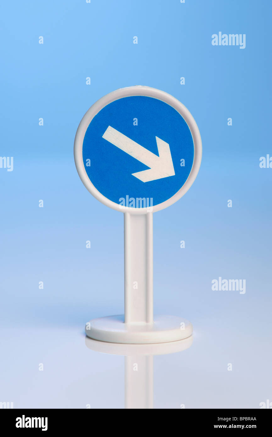 Toy blue arrow sign - Stock Image