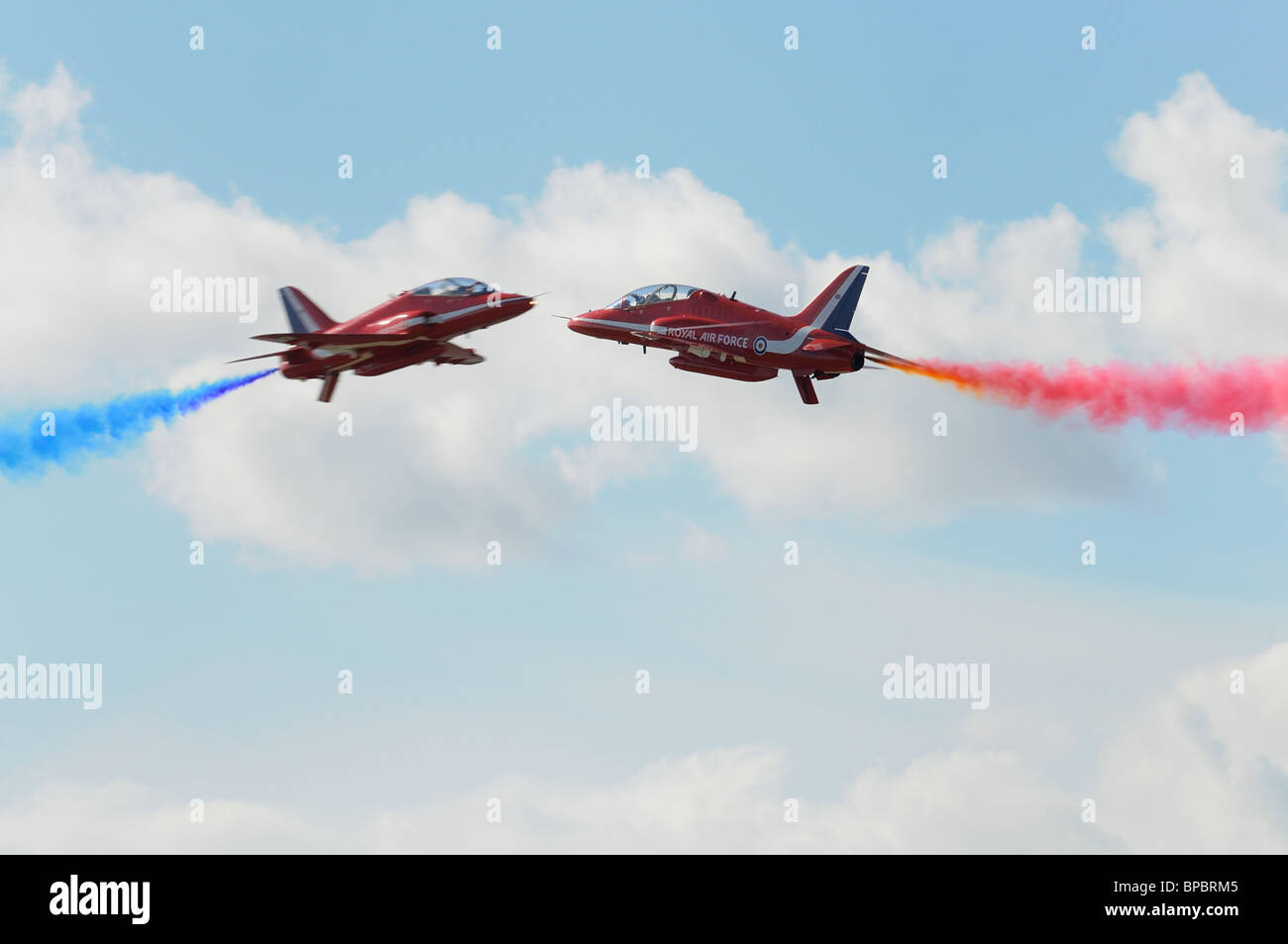 The British Royal Air Force Red Arrows Aerobatic Display Team thrill at the 2010 RIAT Royal International Air Tattoo - Stock Image