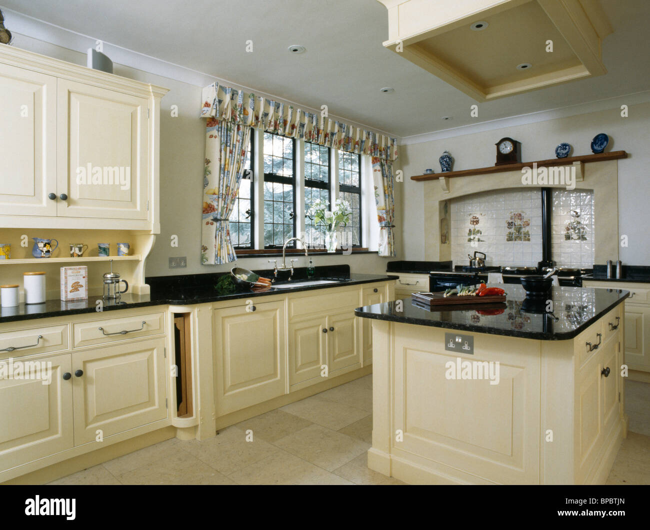 Cream Island Unit With Black Granite Worktop In Large Country