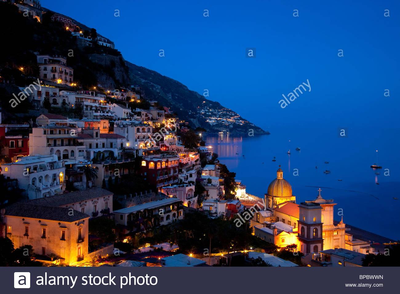 Evening view along the Amalfi coast of the hillside town of Positano, Campania Italy - Stock Image