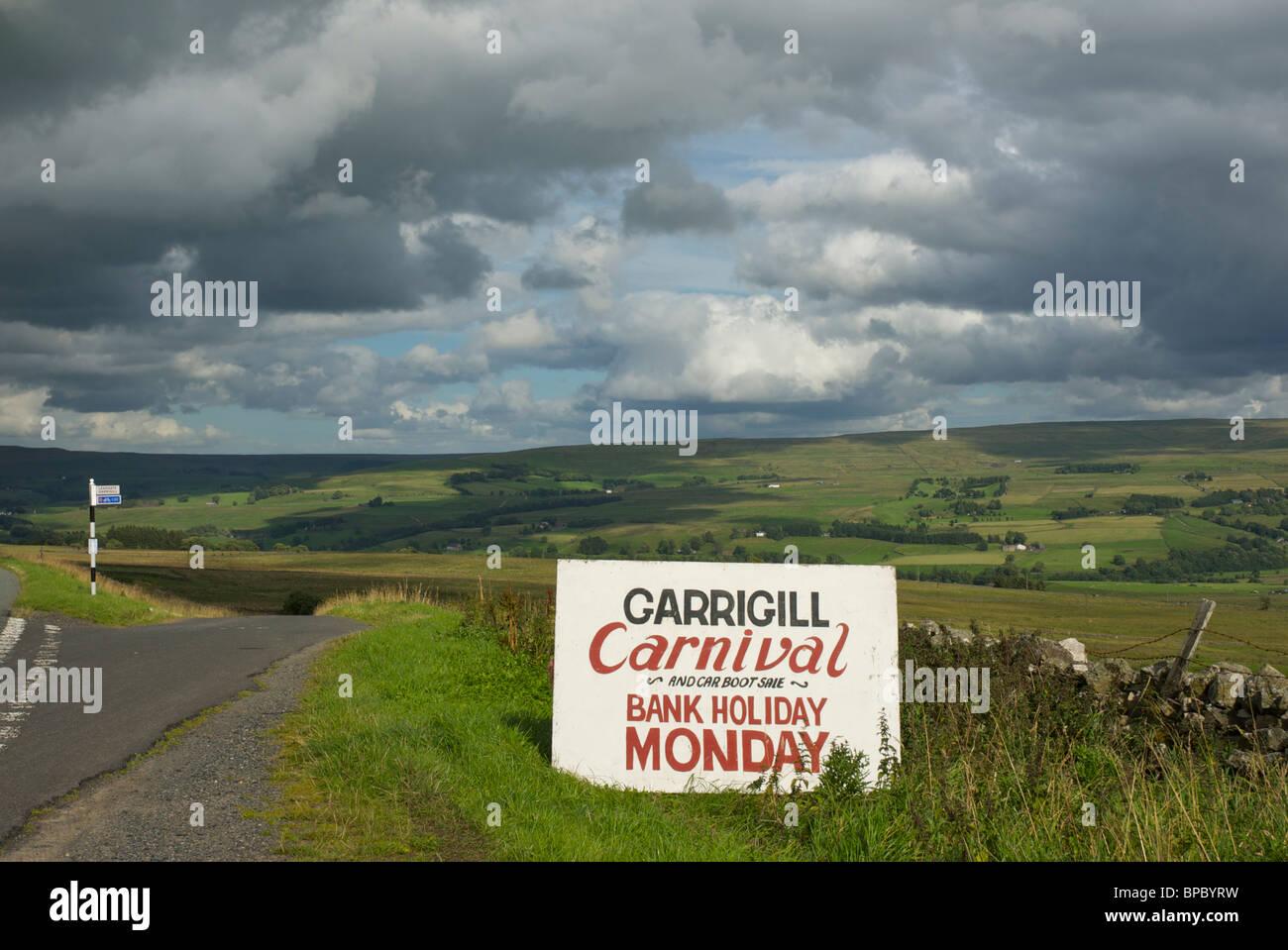 Sign announcing Garrigill Carnival, North Pennines, Cumbria, England UK - Stock Image