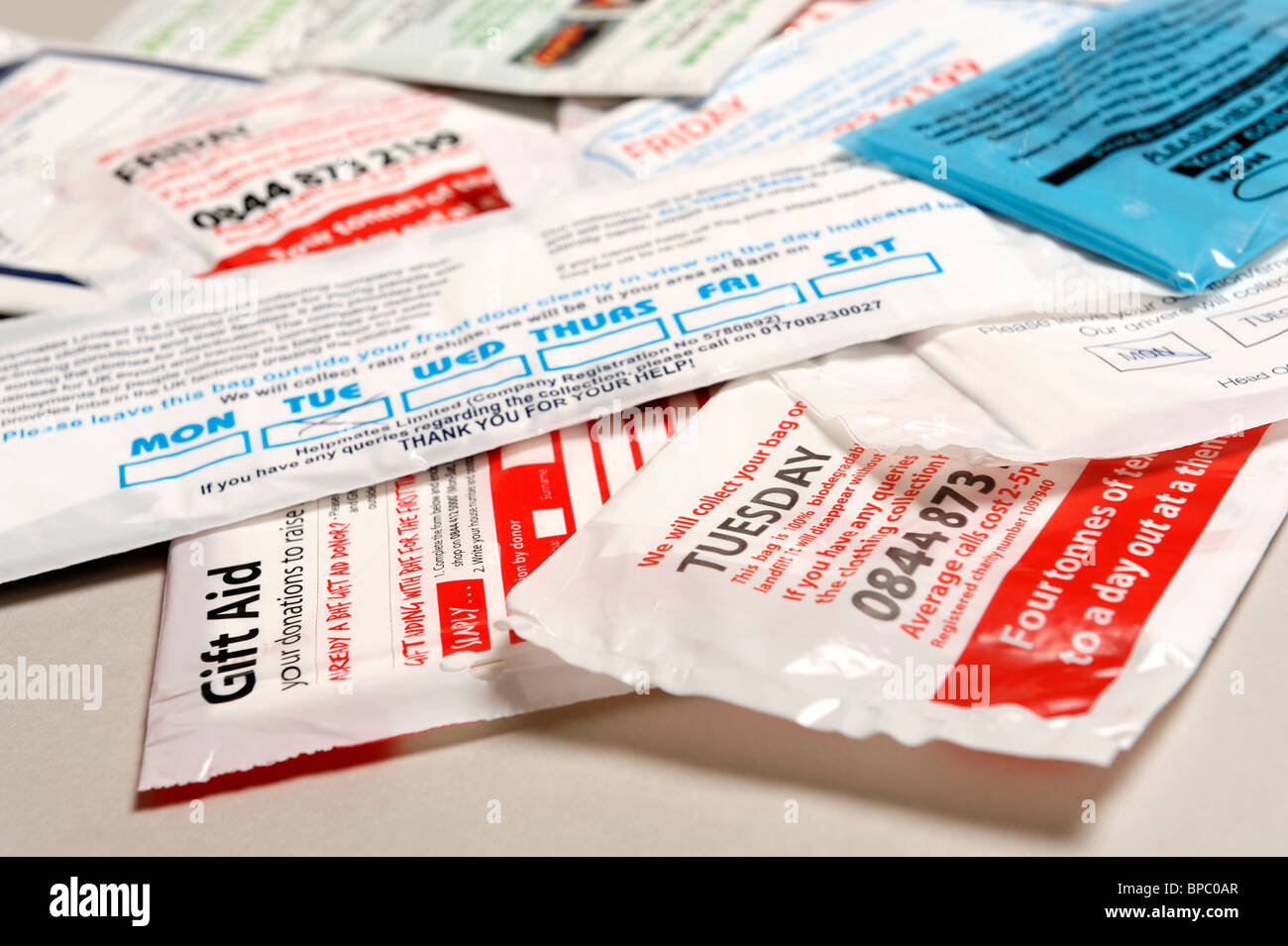 Selection of plastic charity collection bags - Stock Image