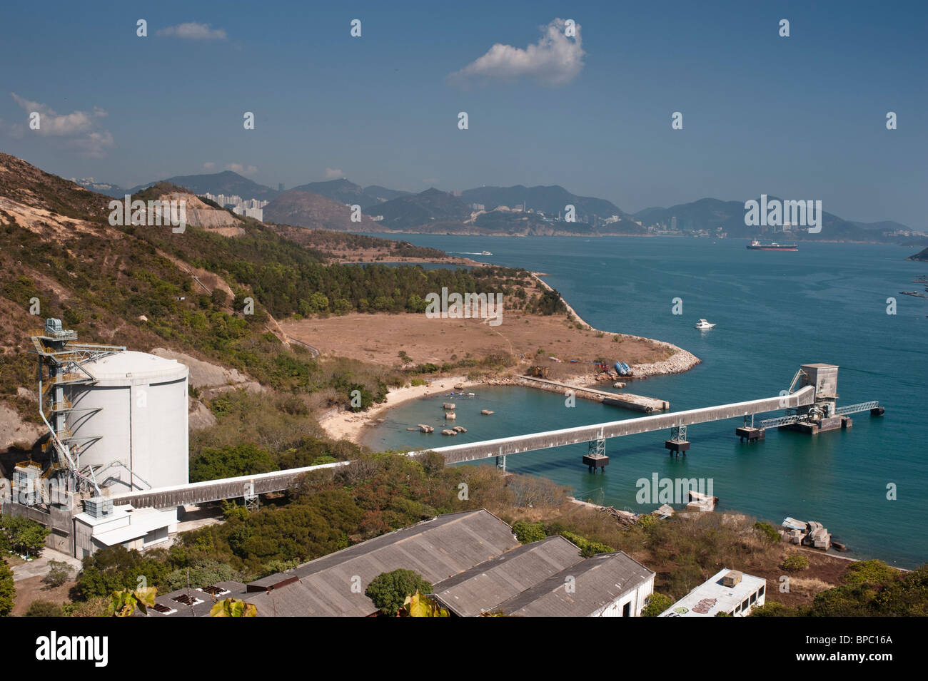 Picnic Bay on Lamma Island with Sok Kwu Wan village. The deserted cement quarry. - Stock Image