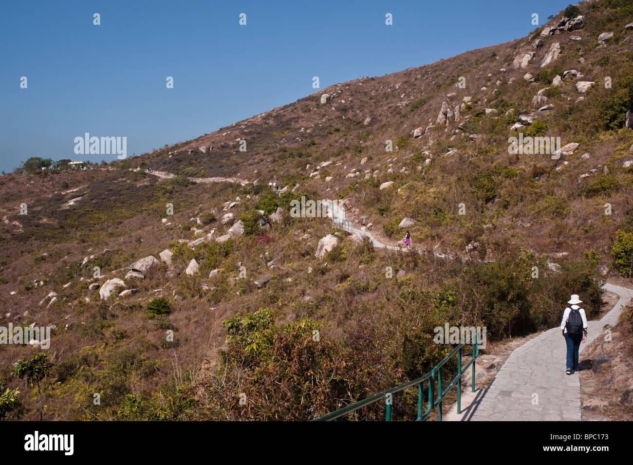 Hong Kong, The Lamma Family trail. Walk from Yung Shu Wan to Sok Kwu Wan through the hills and along the beaches. - Stock Image