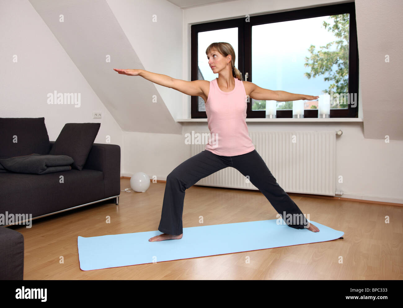 Young woman practice  Yoga exercises at home. Stock Photo