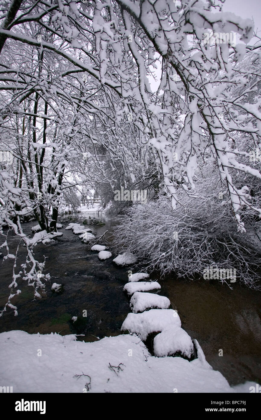 River Bovey in the snow, North Bovey, Dartmoor, Devon, Uk - Stock Image