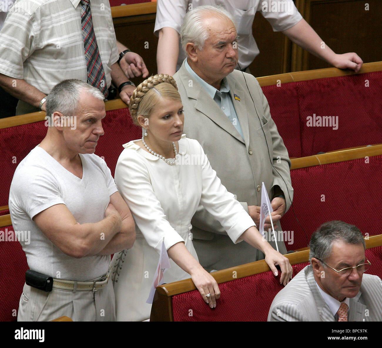 Deputies of Yulia Tymoshenko Bloc (BYT) speak through megaphones attempting to interrupt session of Ukrainian Parliament - Stock Image