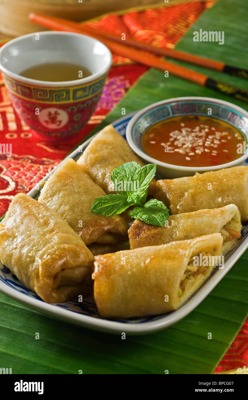 Spring rolls with chilli sauce. Asia food - Stock Image