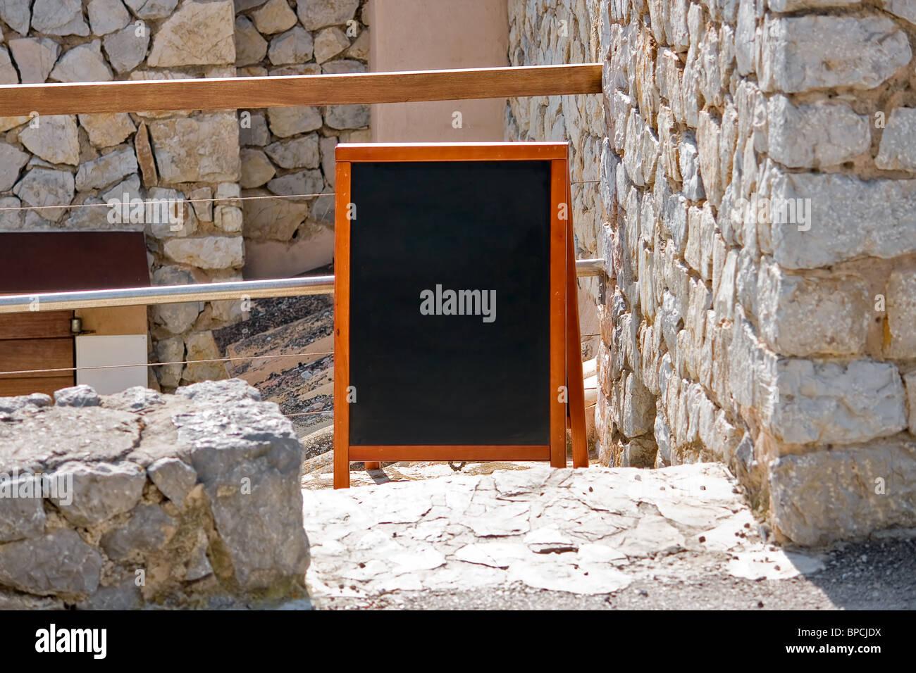 Empty menu board of mediterranean restaurant - Stock Image