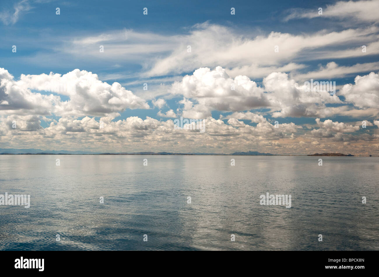 Lake Titicaca reflections of clouds in Peru. - Stock Image