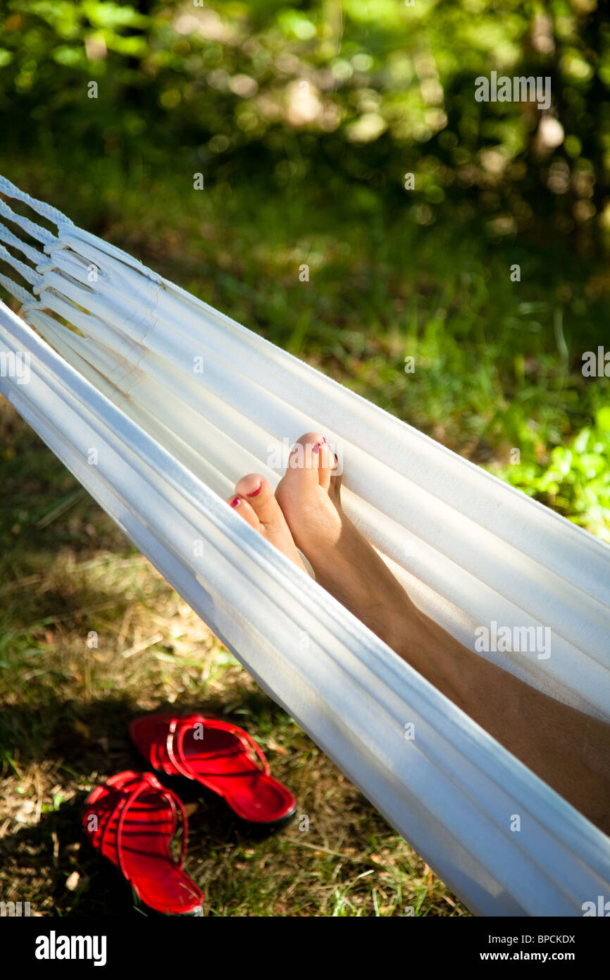woman in a hammock - Stock Image
