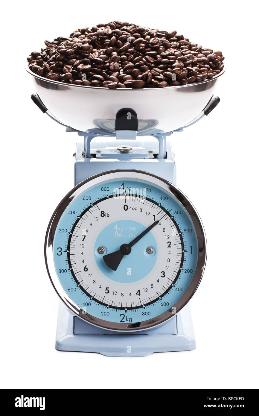 the kitchen scale with coffee beans - Stock Image