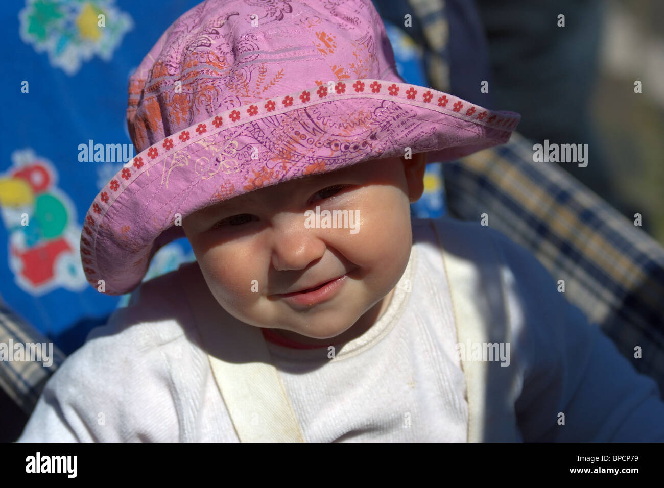 close-up of adorable baby with round cheeks sailor hat and lovely fun expression. Horizontal - Stock Image