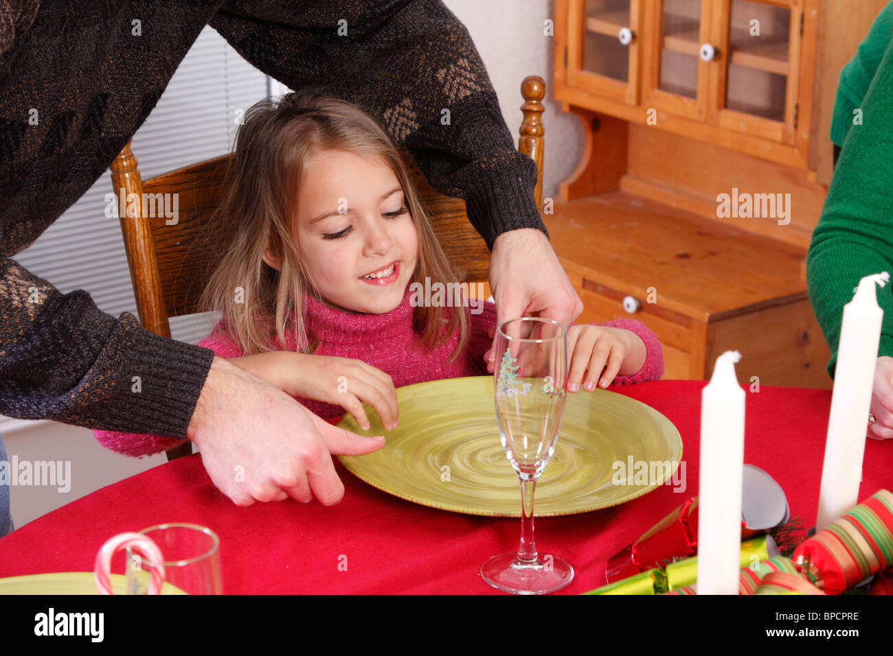 Happy child waiting for Christmas dinner - Stock Image