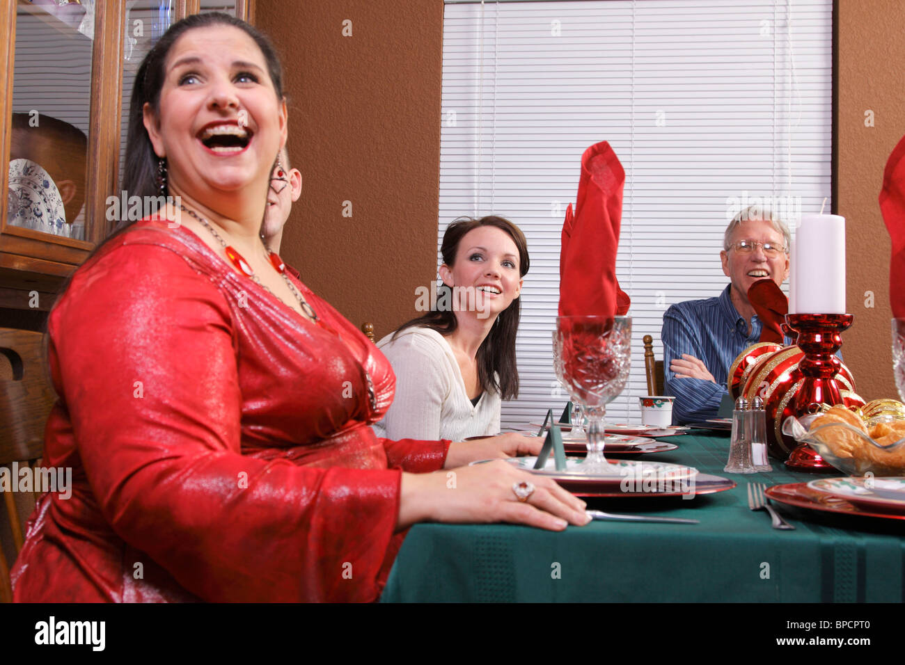 Family sharing Christmas dinner together - Stock Image