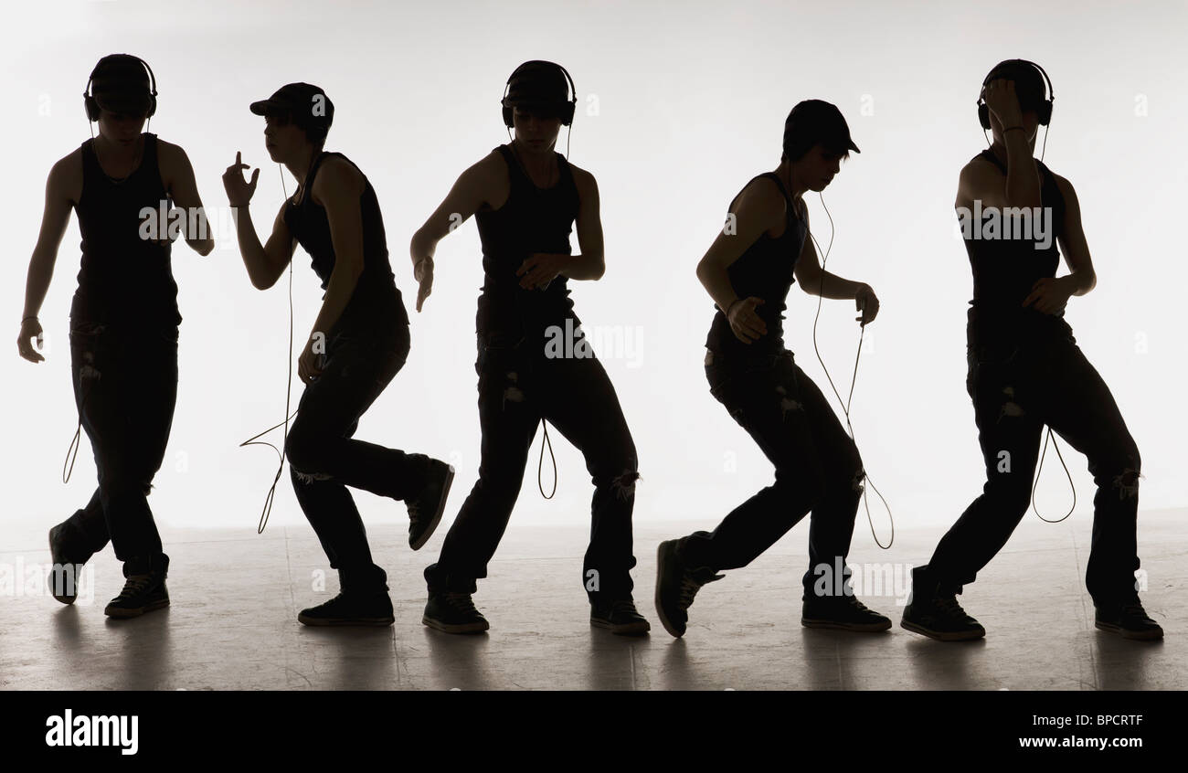 composite image of a boy dancing with headphones Stock Photo