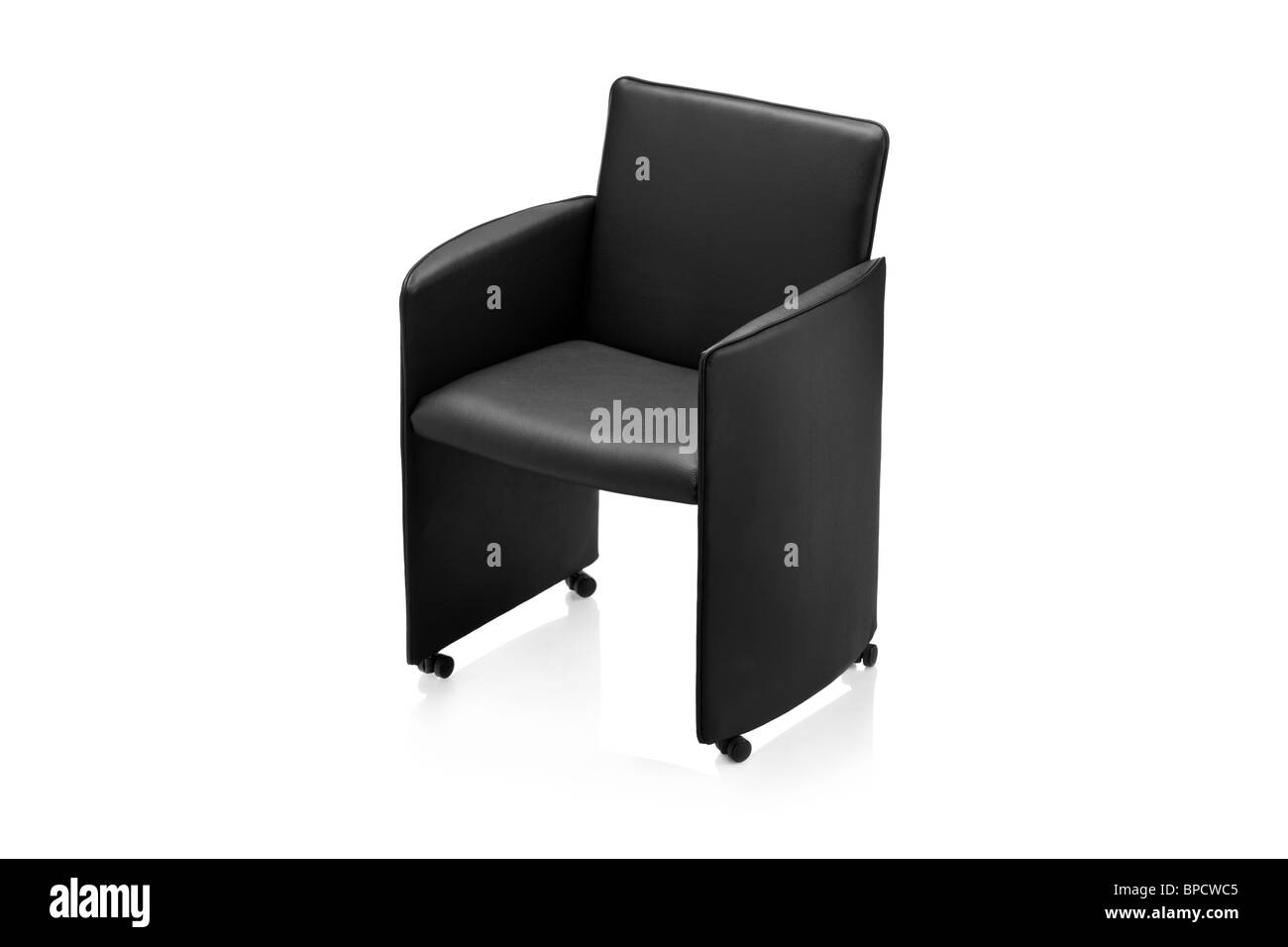 Image of a modern black leather armchair - Stock Image