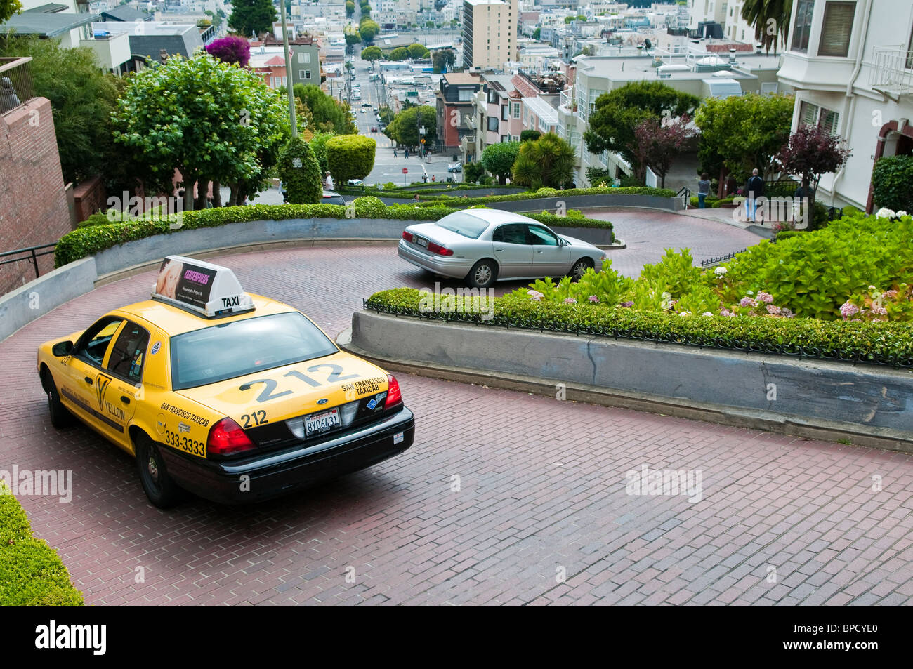 Lombard Street with yellow Taxicab, San Francisco, California, USA Stock Photo
