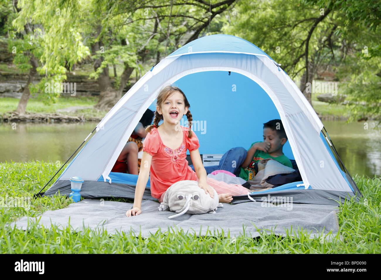 Kids having fun tent camping - Stock Image