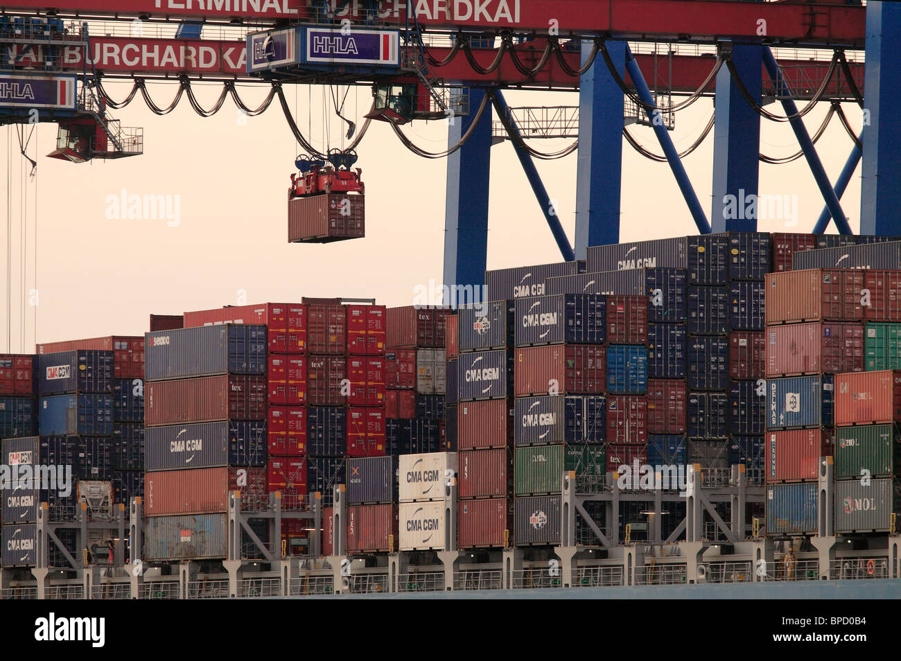 A container ship is being unloaded at the Container Terminal Burchardkai, Hamburg, Germany Stock Photo