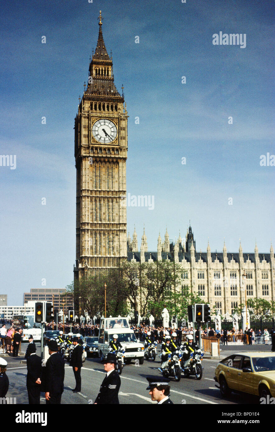 The Popemobile carries Pope John Paul II pass Big Ben and the Houses of Parliament during his visit to Britain Stock Photo